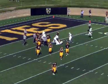 Video screen capture from Gustavus Adolphus broadcast with helmet visible on ground.