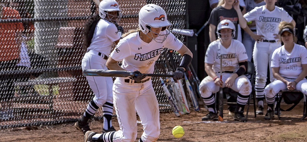 Sammie West collects one of her six hits on a bunt in game one (photo by Chuck Williams)