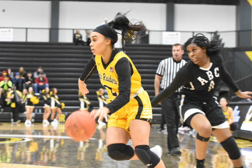 Hollis keeps making 3's as Lady Raiders rout Buffaloes