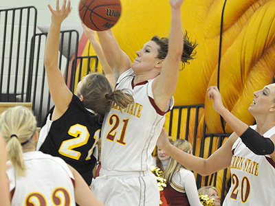 Ferris' Kelsey DeNoyelles blocks a Michigan Tech shot in the Bulldogs' upset (Photo by Rob Bentley)