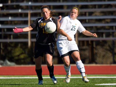 Kelsey Aubil's battles Northern Michigan's Caitlin Glendenning for the ball during Sunday's regular-season home finale.  (Photo by Ben Amato)