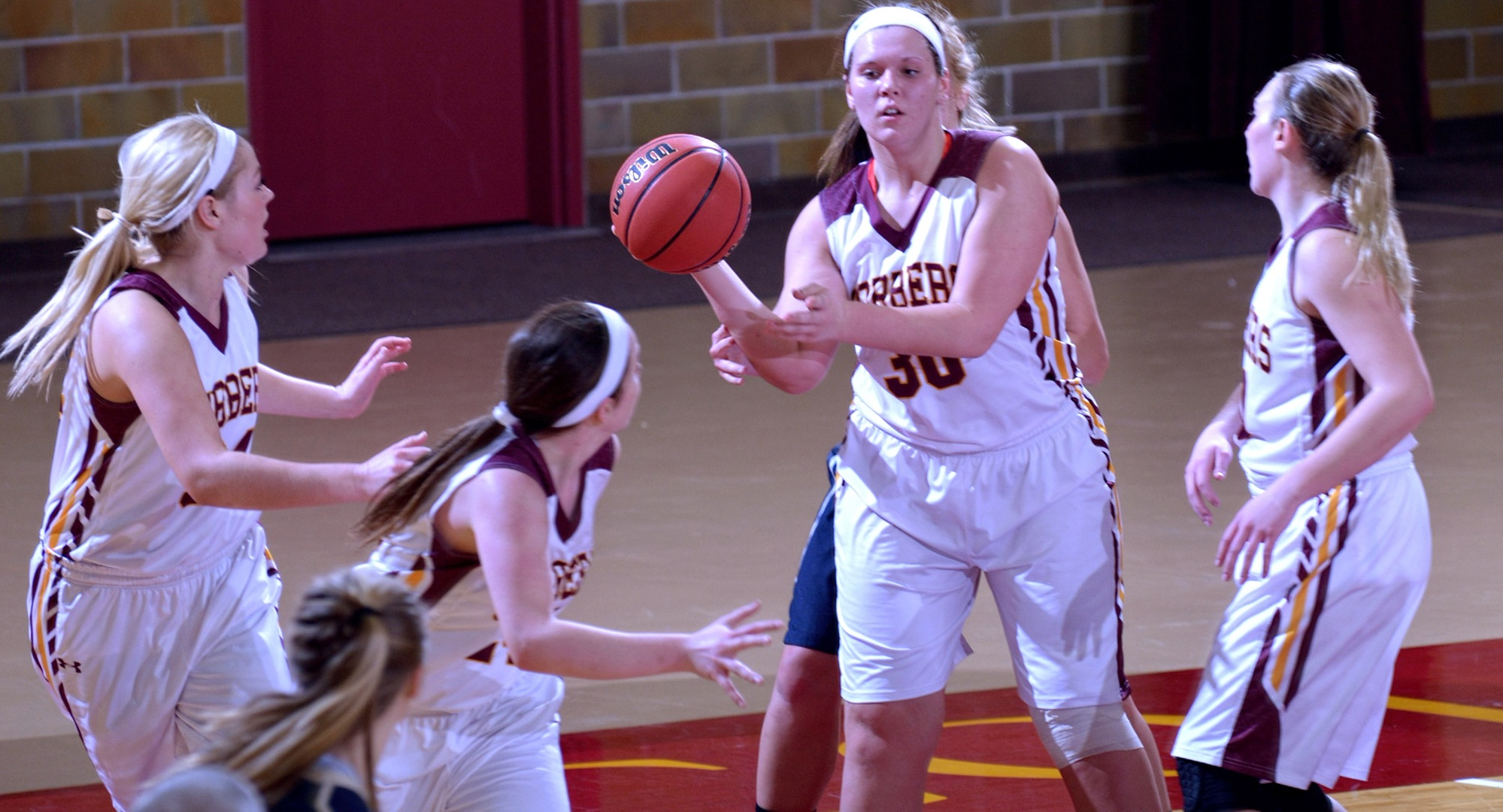 Freshman Shelby Duckstad outlets the ball after grabbing one of her career-high five rebounds. She also scored a career-high 16 points in the Cobbers' game with Bethel.