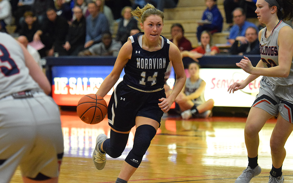 Senior Karlie Brogan drives towards the basket in a game at DeSales University.