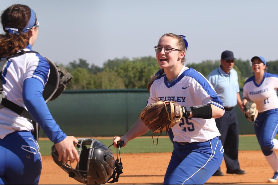 Hayley Moniz and Autumn Brown celebrate the game one victory over Colby (Robert Oliver).