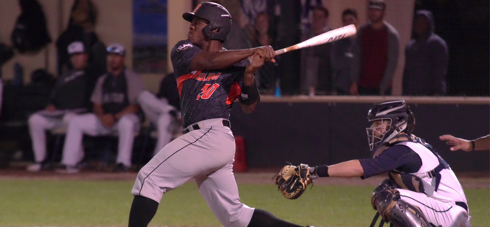 Jarel McDade lines this RBI single to spark a 5-run 8th inning in Tusculum's 6-4 win over Palm Beach Atlantic (photo by Chris Lenker)