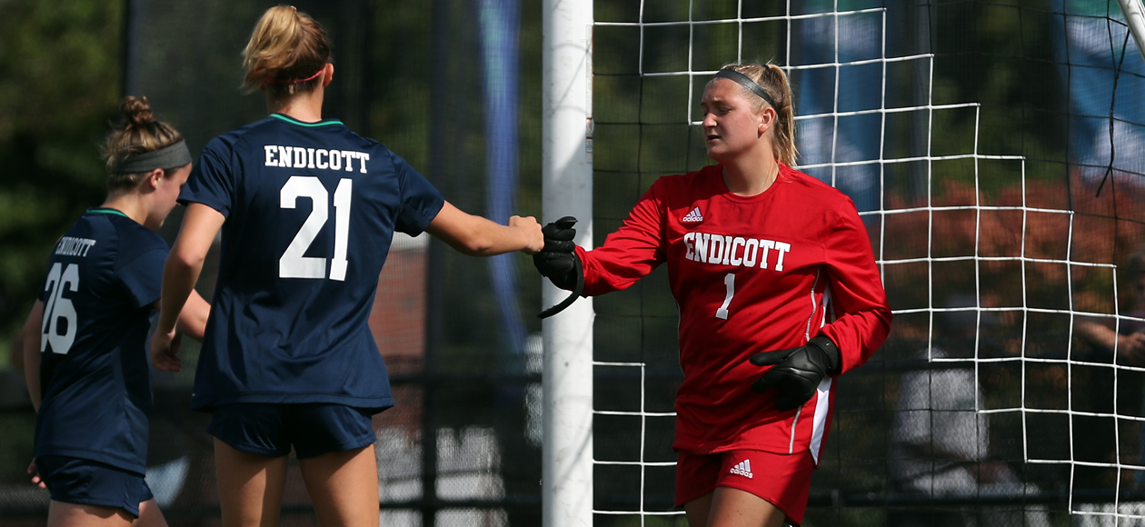 Keeper Kayla Wentworth and her defense fist bump after making a play.
