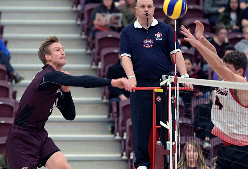 Max Vriend hits one off the Winnipeg block on the weekend. The outside hitter recorded 28 kills on Saturday to break the MacEwan University Canada West single match record (Chris Piggott photo).