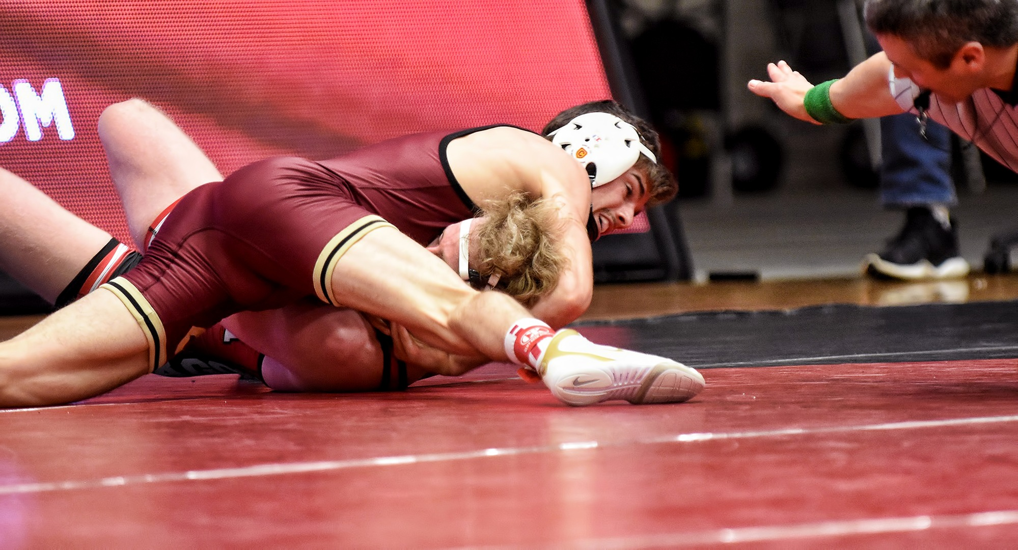 Junior Cole Kubesh gets his opponent's shoulders on the mat in his match at 125. He wound up winning by pin to earn his team-leading 15th win of the year.