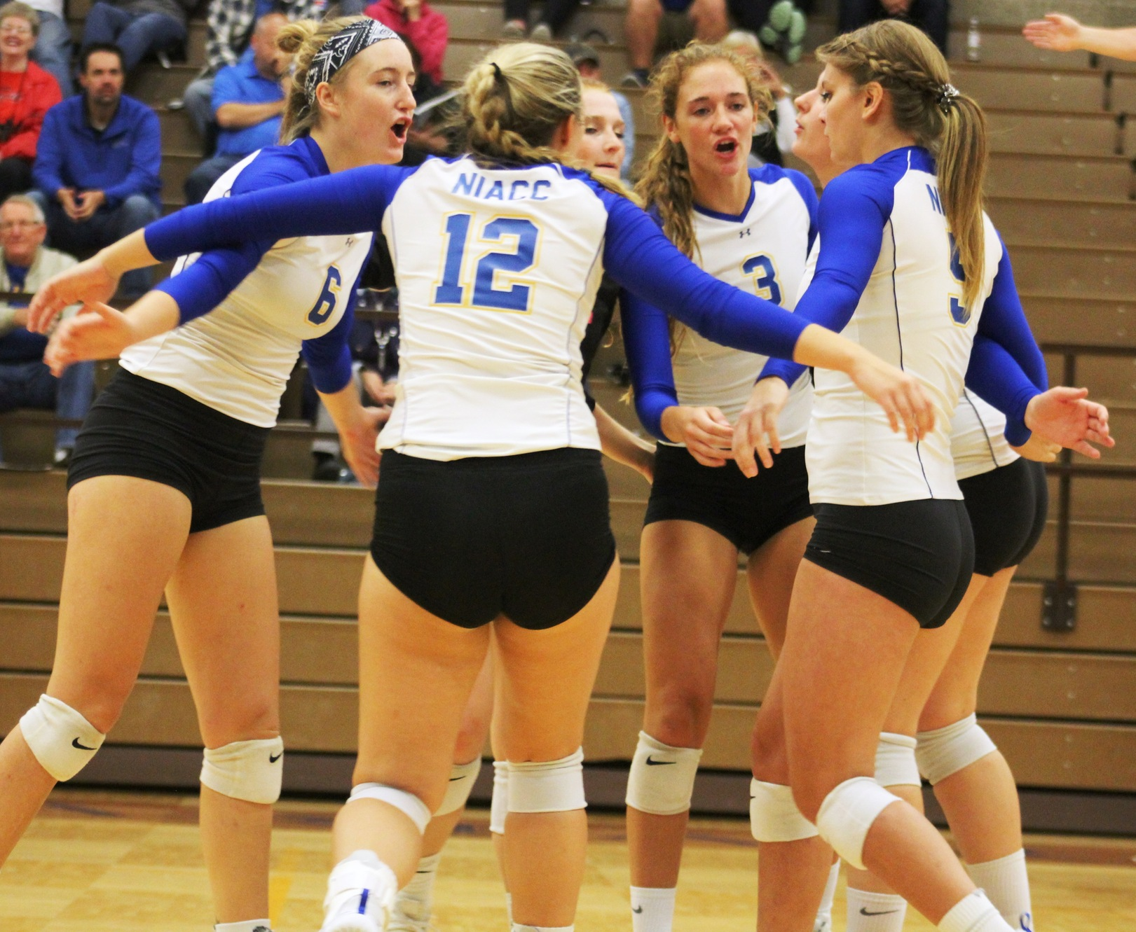 NIACC players celebrate a point in this season's match against Ellsworth.