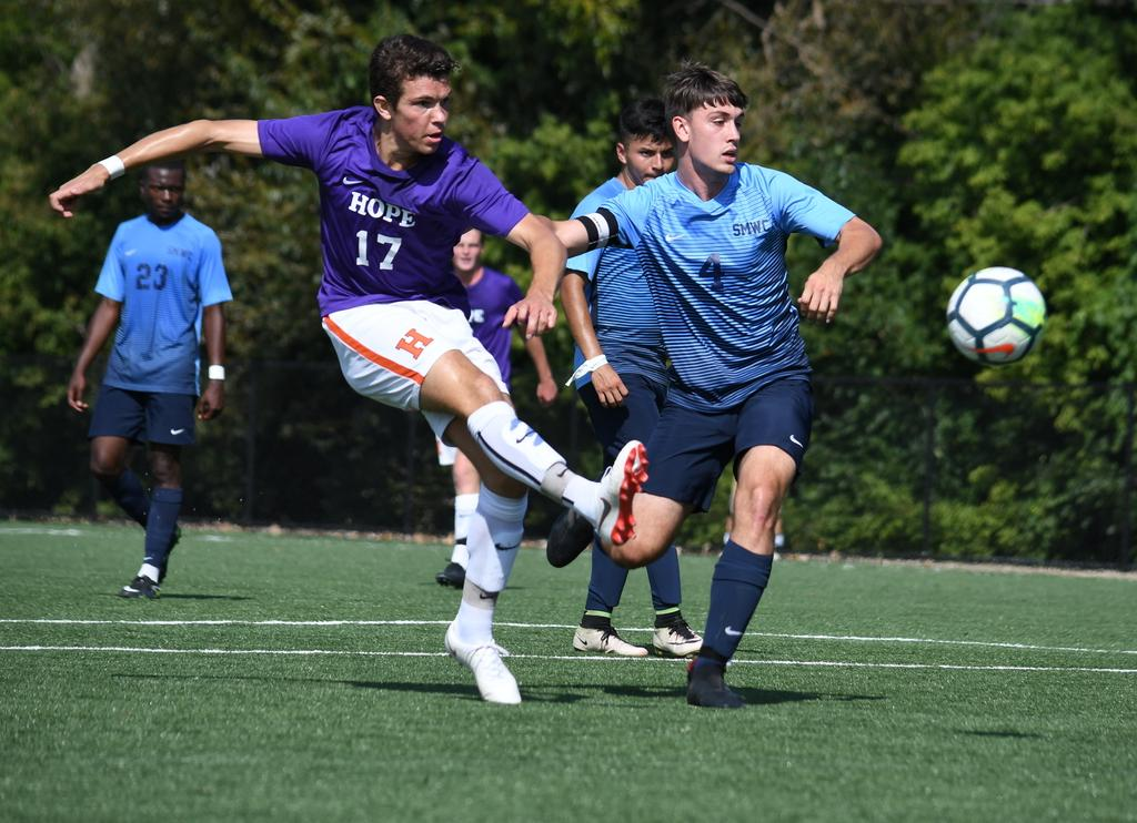 Jack Elwell kicks the ball forward during the Purple Community game