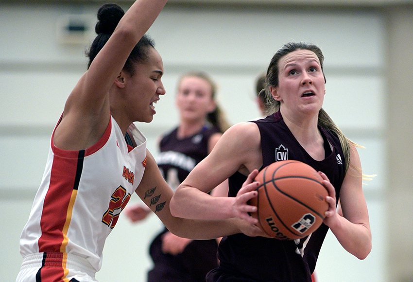 Kayla Ivicak drives against Calgary's Reyna Crawford on Saturday. She had a game-high 19 points and 11 rebounds for her sixth double double of the season (Chris Piggott photo).