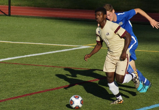 Bienfait Badibanga men's soccer action vs. Maine Maritime