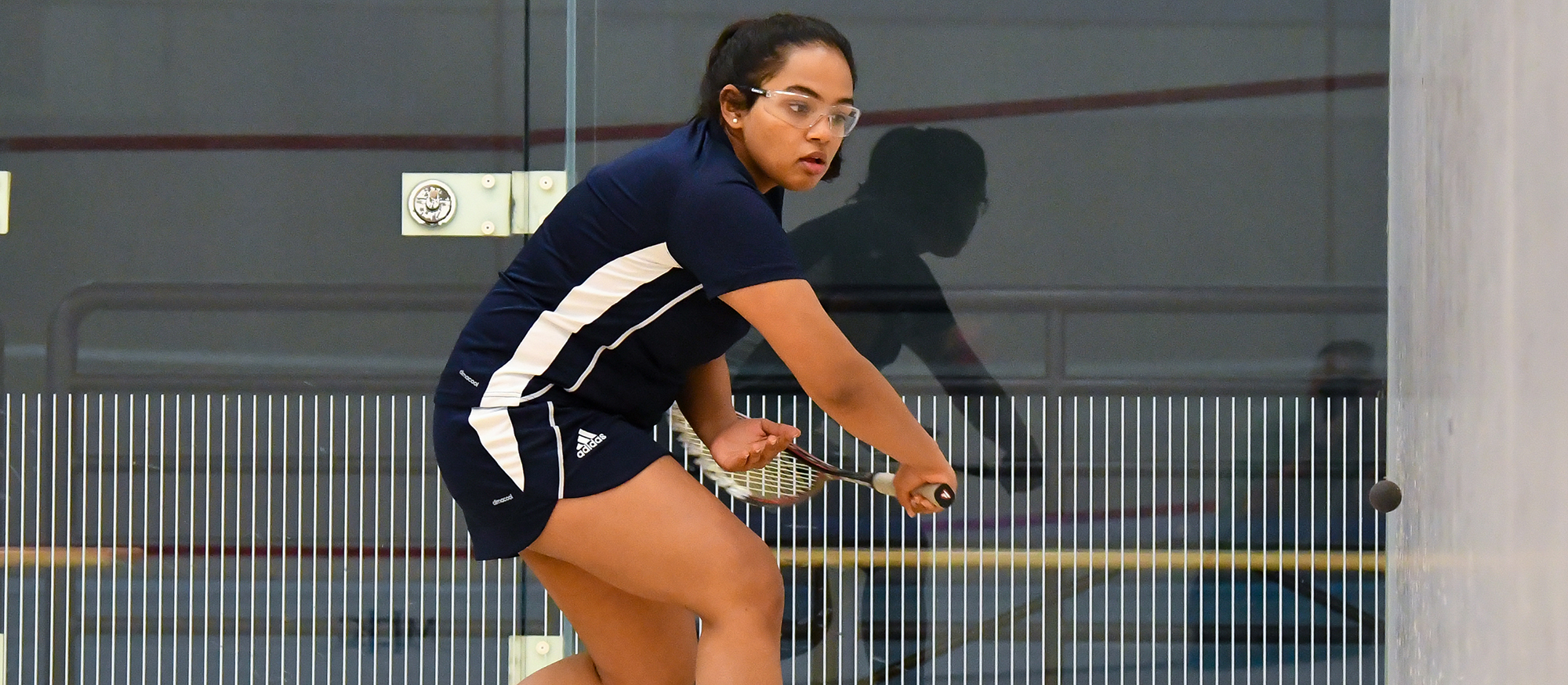 Action photo of Lyons squash player, Tanishka Sachidanand.