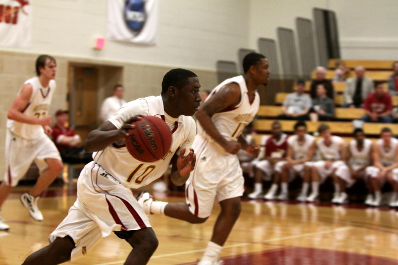 Second Half Surge Propels Men's Hoops Past Pirates