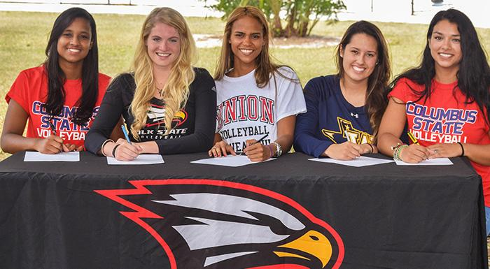 Polk State sophomores Dayanna Teixeira, Laina Blanton, Suheily Colon, Elisabeth Piroli, and Zoemy Barreto sign letters of intent to play volleyball at four-year schools. (Photo by Denise James, Polk State.)