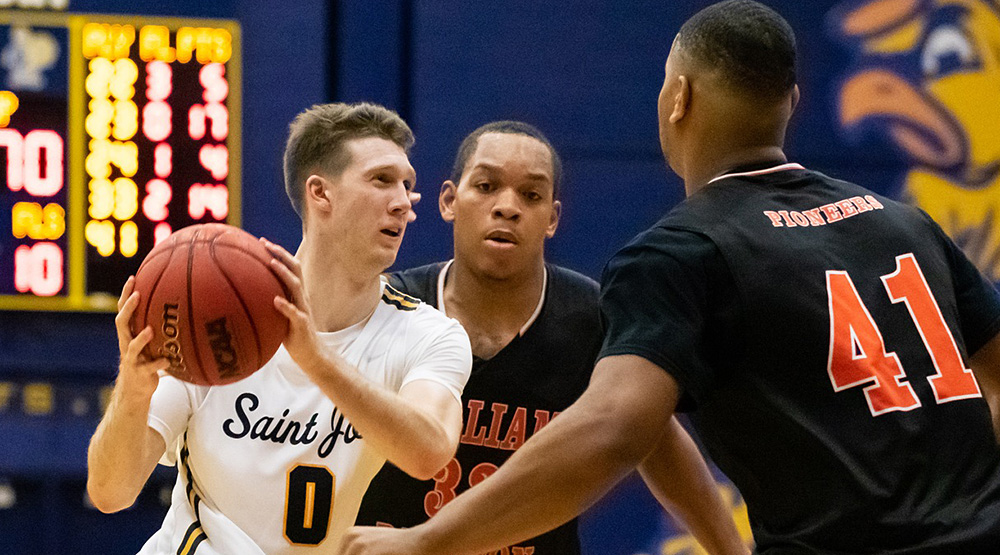 Ryan O'Neill works on the perimeter against two William Paterson players. (St. Joseph, Conn., athletics photo)