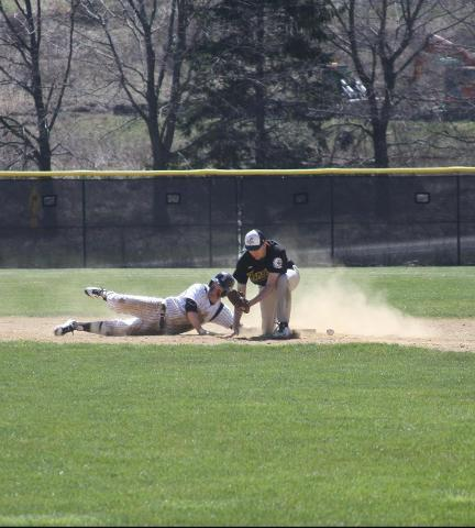 Broome player sliding into third