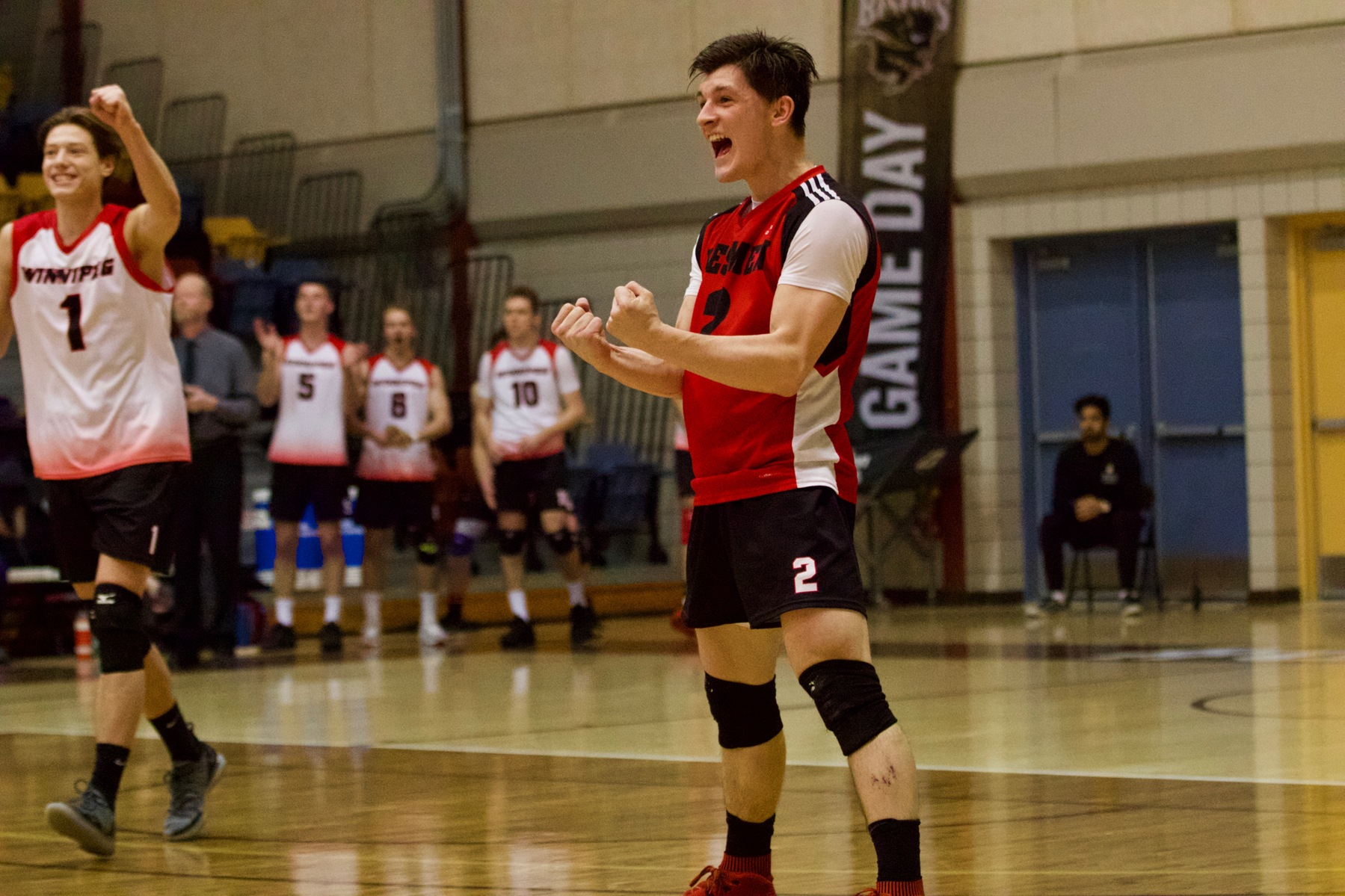 Wesmen libero Darian Picklyk, right, and teammate Austin Anderson celebrate a big block for a point during the first set of the Wesmen men's volleyball team's win over the Manitoba Bisons Friday, February 1, 2019. (David Larkins/Wesmen Athletics)