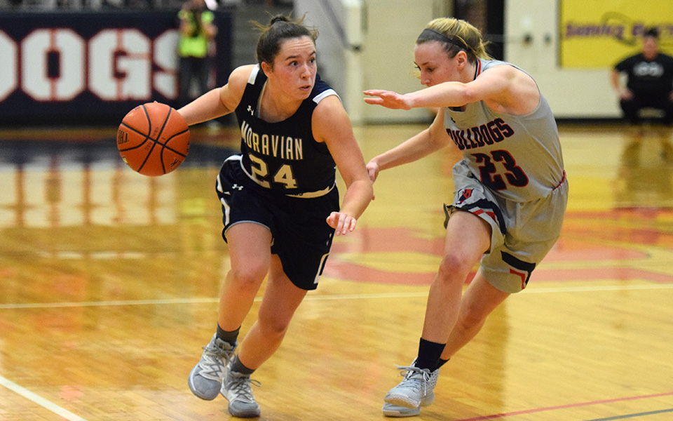 Freshman guard Morgan Amy dribbles on the offensive end in the first half at DeSales University.