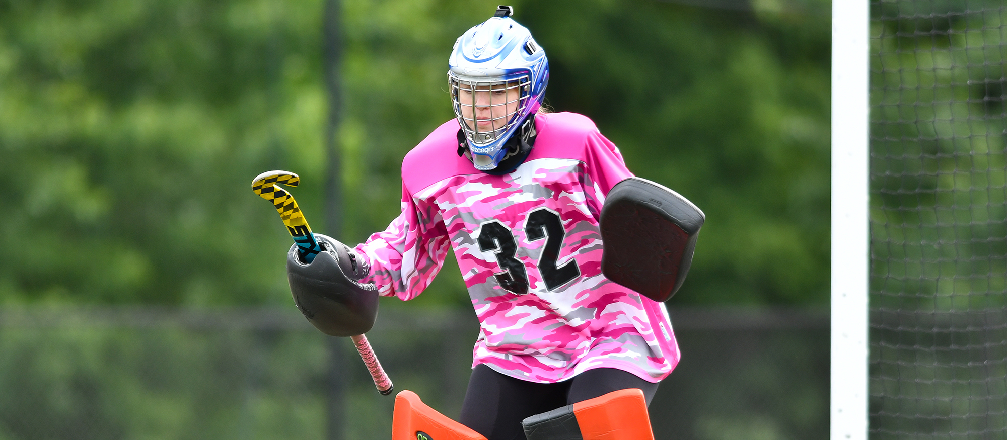 Action photo of Lyons field hockey goalie, Maddie Miller.
