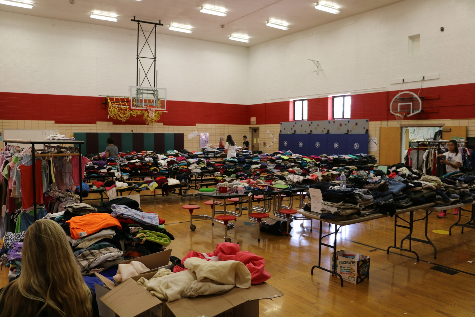 Volleyball Team Assists with Clothing Drive