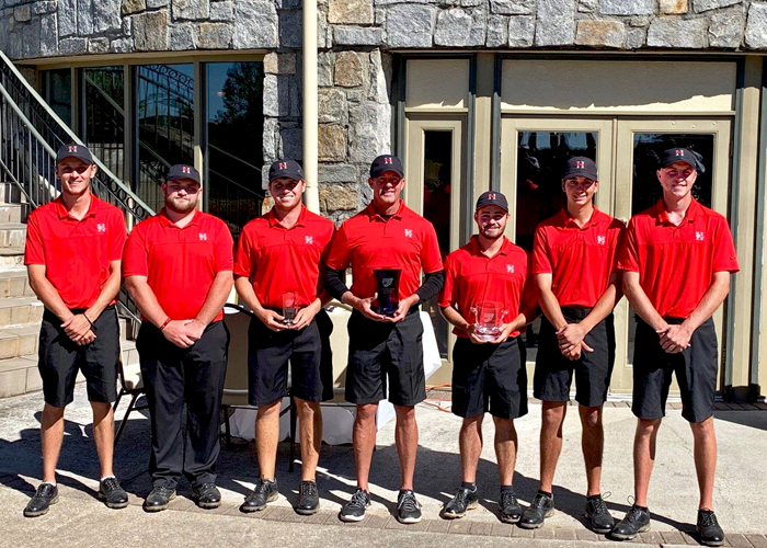 Stephen Shephard (third from right) earned medalist honors and the second-ranked Hawks won the Emory Invitational on Sunday.