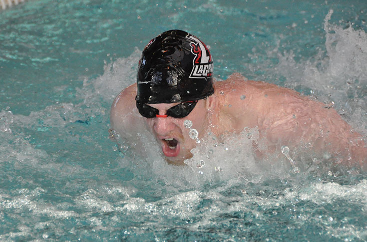 Swimming: Ben Fuller takes three first place finishes against Warren Wilson