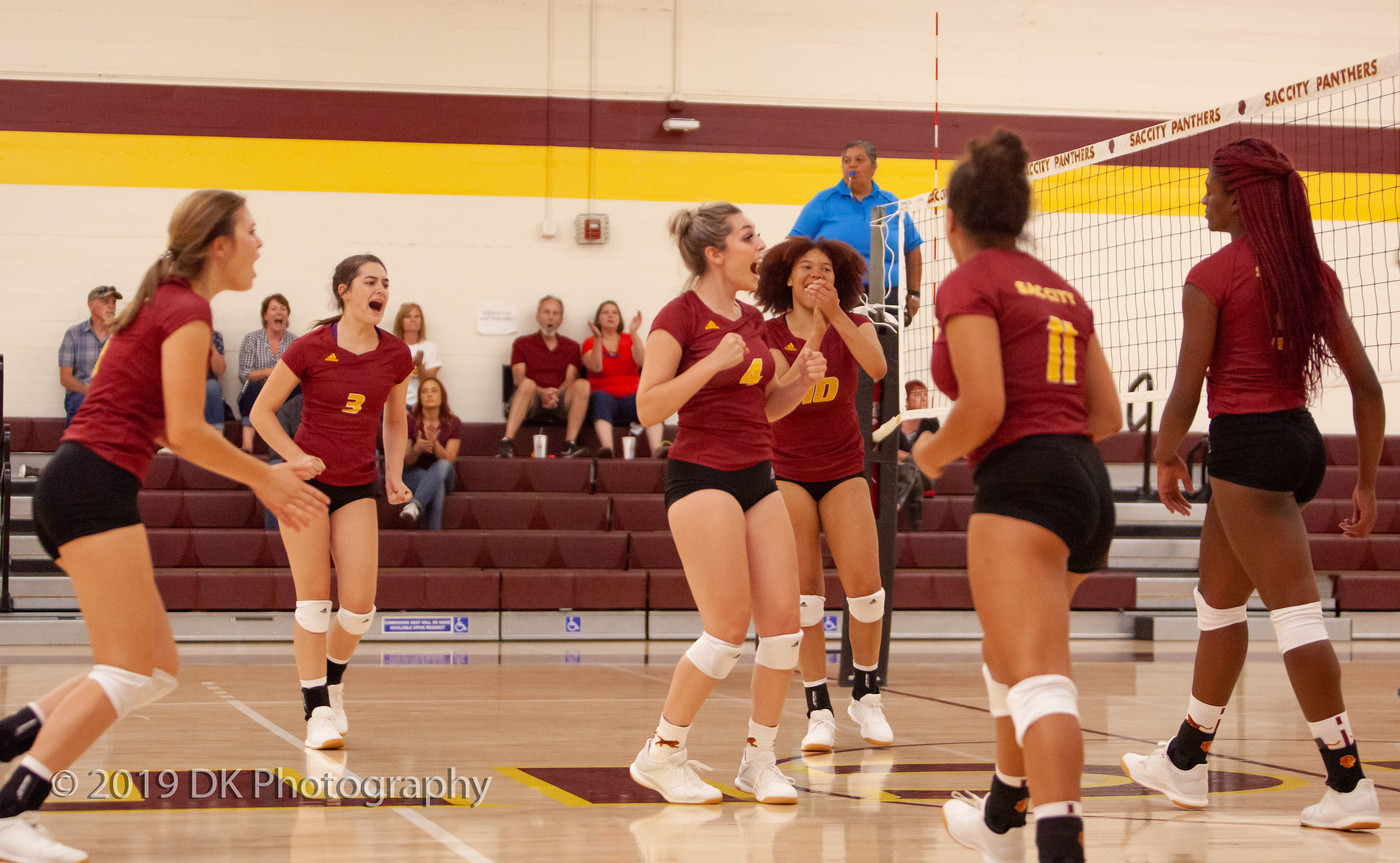 City College reacts after winning the point in the match against Butte College at the North Gym on Aug. 30th.
