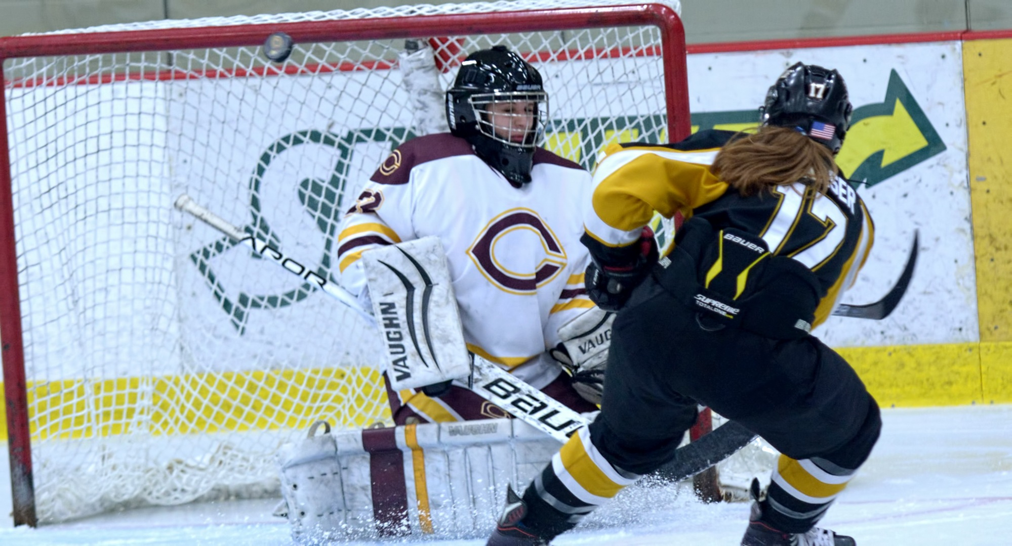 Cobber goalie Brittany Boss watches the puck deflect away from goal after making a save during the second period of the Cobbers' series finale with St. Olaf.