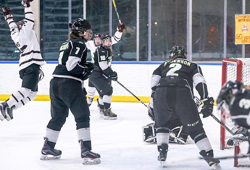 Carley Jewell and Shyla Jans celebrate Jewell's game-winning goal over the Red Deer College Queens in Game 1 last week. MacEwan has scored just two goals on Queens goaltender Tracie Kikuchi in the series, which is tied 1-1 (Matthew Jacula photo).