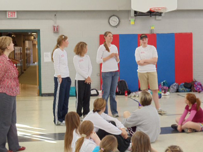 Ferris State women's golf team members Jacqueline DeBoer, Emily Rohdy, Bryce Hetchler, and Cooper Shawen  attend one of the Girls on the Run events at Brookside Elementary School.