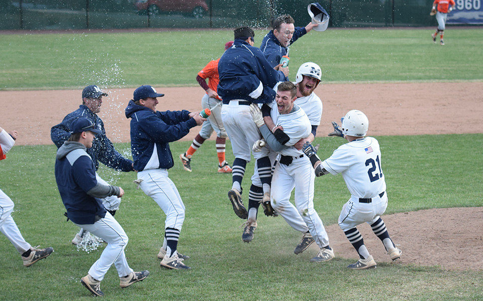 The Greyhounds race toward freshman AJ Brosious to celebrate after his RBI sacrifice fly gave the Hounds a 7-6, 13-inning walk-off win over Susquehanna University at Gillespie Field.