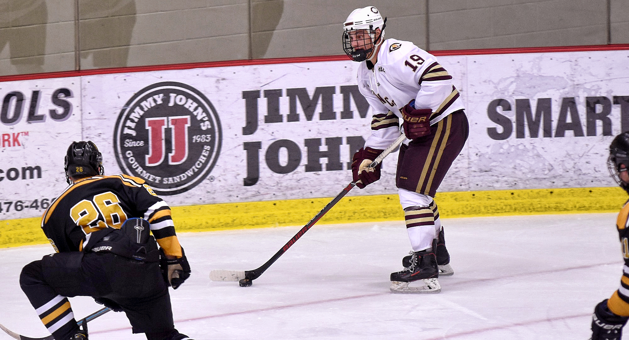 Sophomore Tyler Bossert looks to move the puck on the power play in the second period of the Cobbers' 5-1 win over St. Olaf.