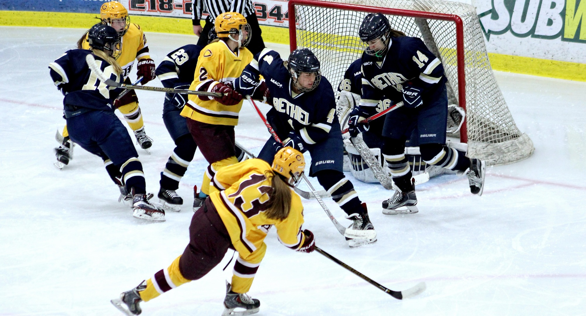Senior Jessie Kongelf (#13) follows through on her goal in the first period of the Cobbers' 7-3 win against Bethel in the regular-season finale.