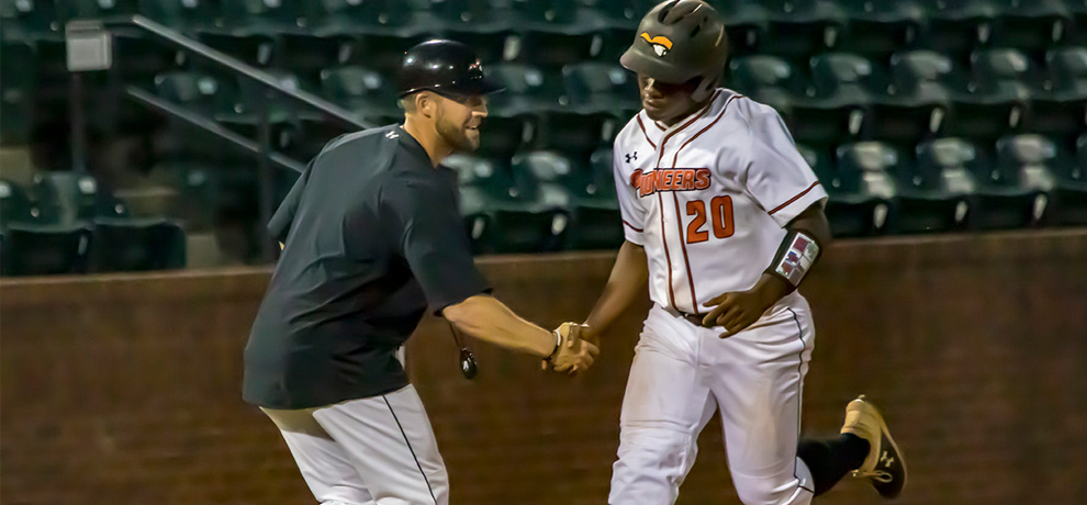 Jarel McDade is congratulated after hitting his 3-run HR in the seventh inning in TU's 9-0 win over Coker (photo by Chuck Williams)