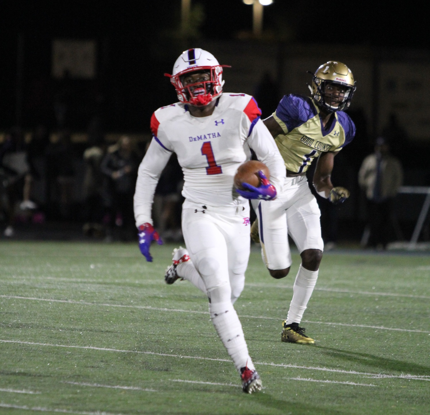 DeMatha Senior DeMarcco Hellams (shown) and Senior Nick Cross were all over the field in the Stags win.