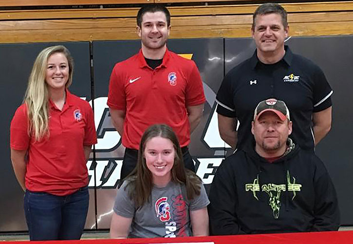 PICTURED: Sitting (L to R) – Savana Fuller and Shane Fuller, Savana's father. Standing – Mallory McArtor, Southwestern assistant softball coach; Nick Weinmeister, Southwestern head softball coach; and Tim O'Brien, ACGC High School head softball coach.