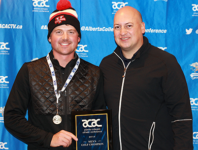 Michael Harrison, left, receives his men's individual award from Joel Mrak on behalf of the ACAC on Sunday (Jefferson Hagen photo).