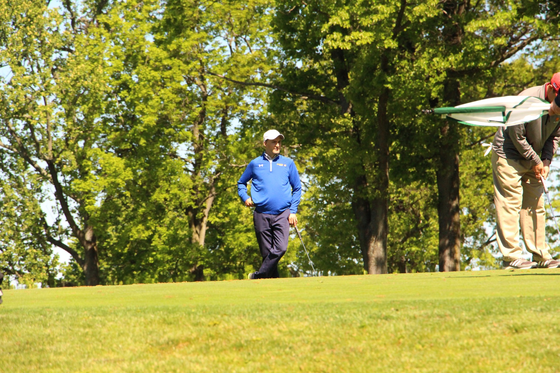 Head Coach Brown Prepares for Inaugural Golf Season by Maintaining a Competitive Edge
