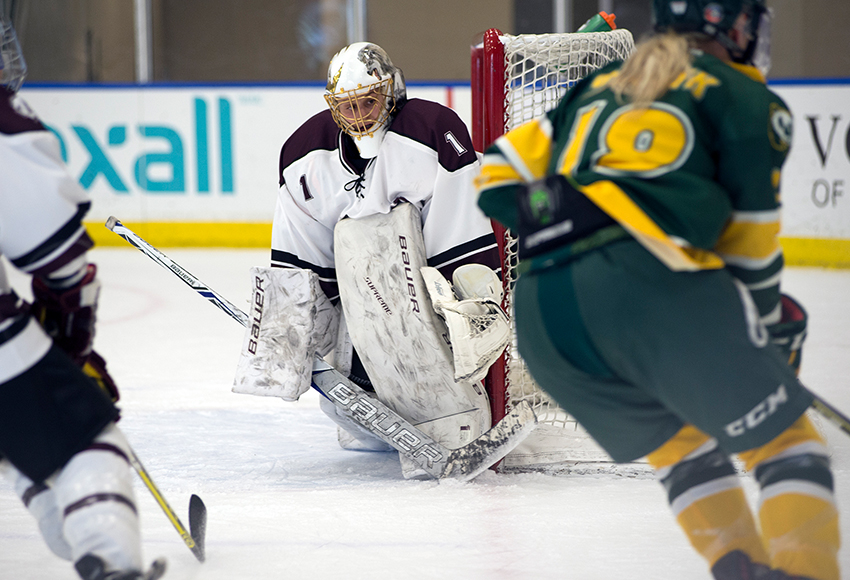 MacEwan Griffins goaltender Sandy Heim stares down University of Alberta Pandas forward Hannah Olenyk during a match last Friday at the Downtown Community Arena (Len Joudrey photo).