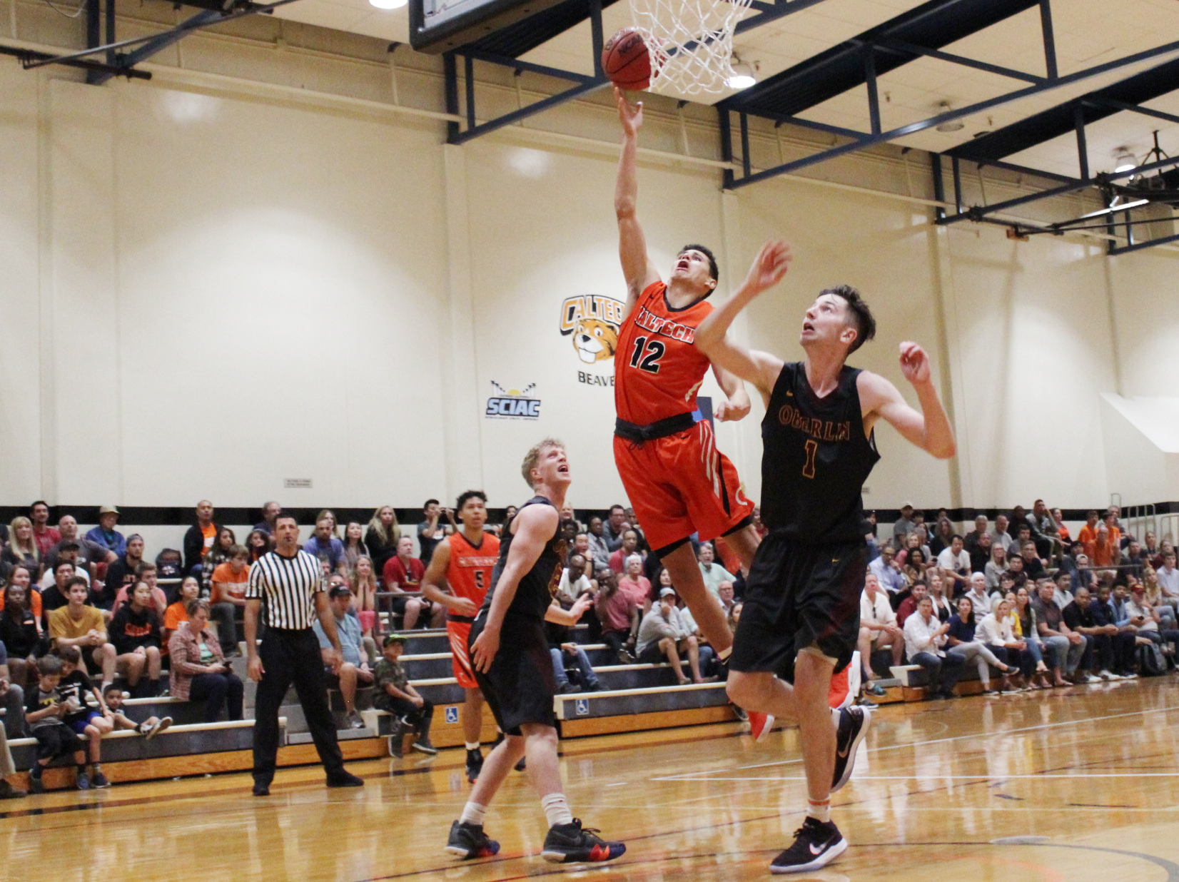 Men's Basketball Rallies, Stuns Carleton