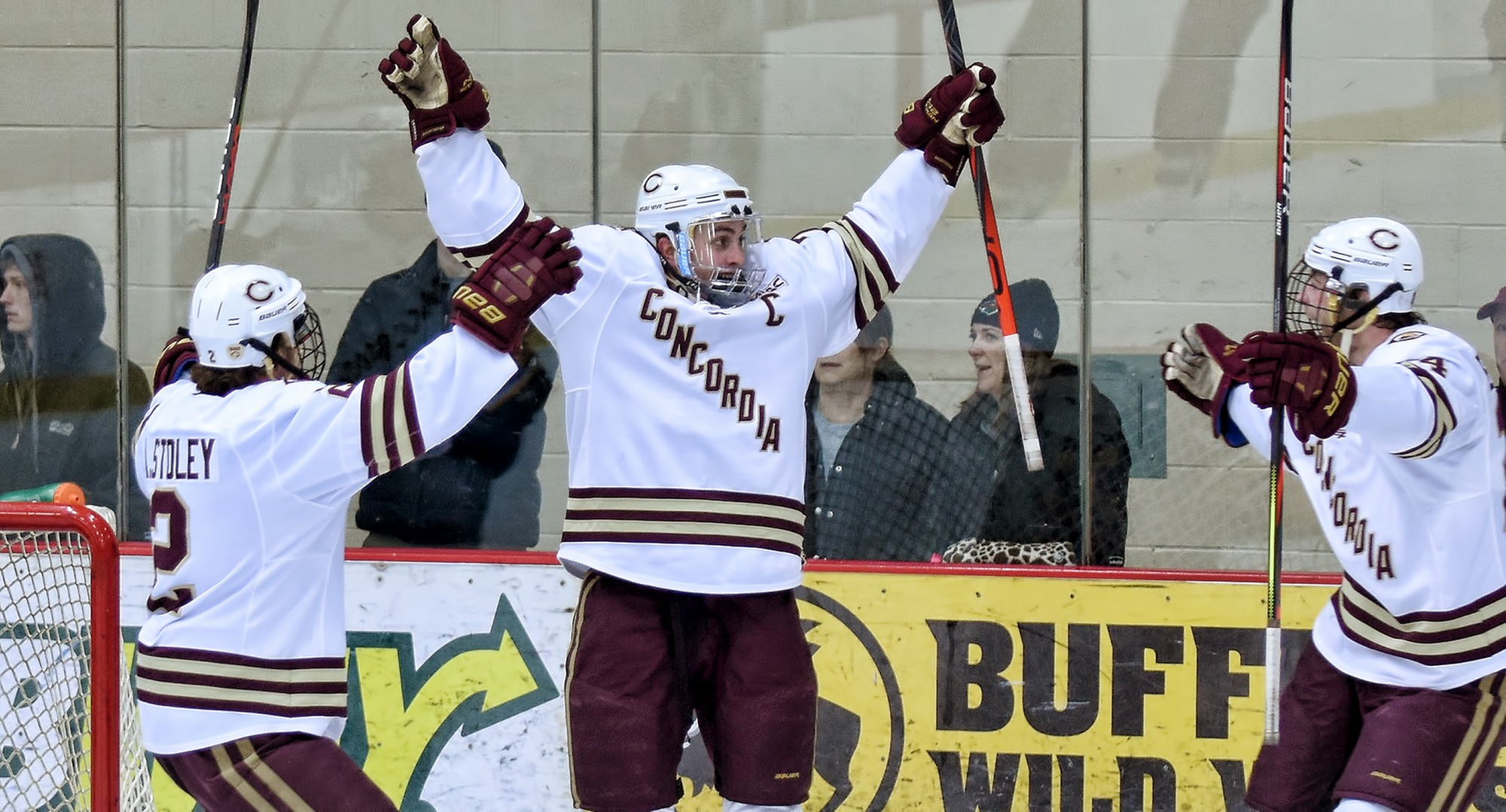 Senior captain Joe Burgmeier raises his arms in celebration after scoring the game-winning goal against No.3-ranked Wis.-Eau Claire.