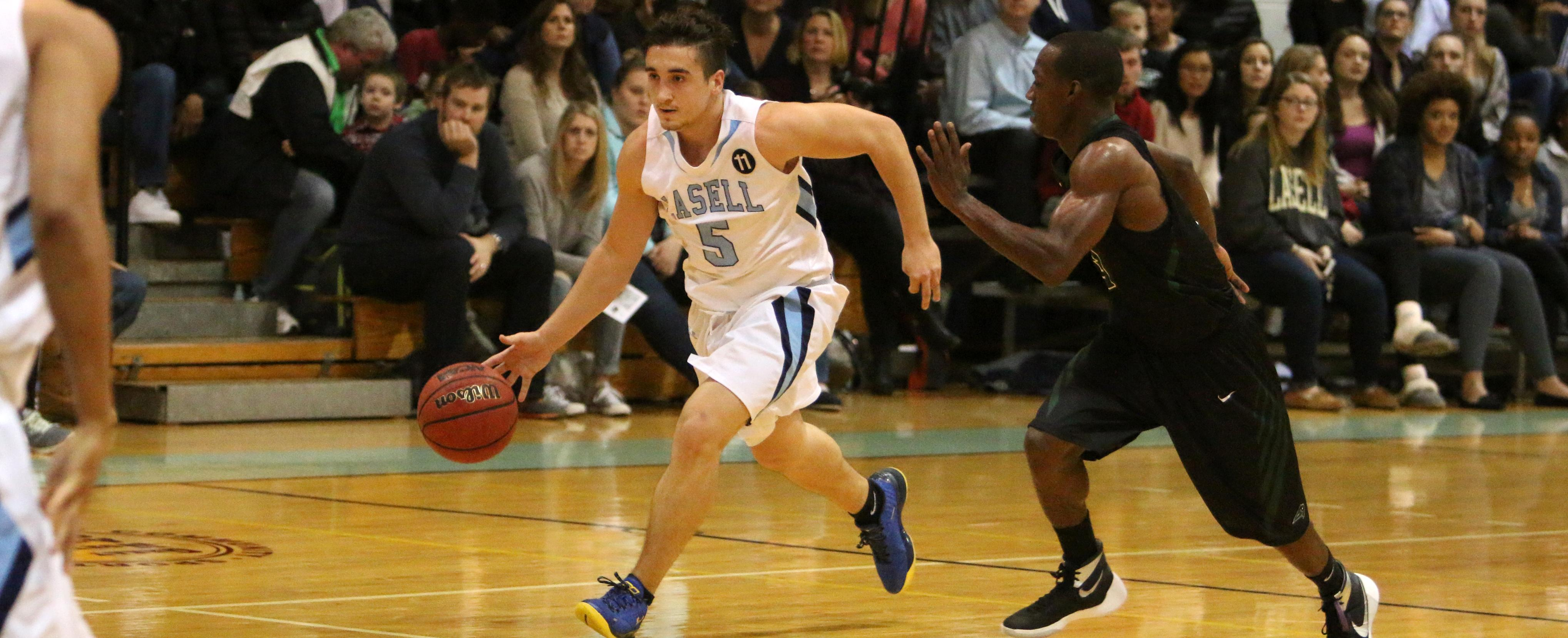 Omanovic Beats the Overtime Buzzer to Propel Men's Hoops Over Rivier 78-75