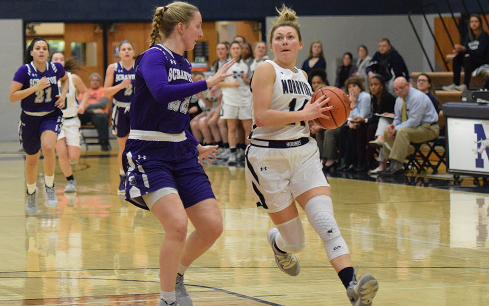 Senior guard Karlie Brogan drives to the basket after a steal in the first half versus No. 10 The University of Scranton in Johnston Hall.