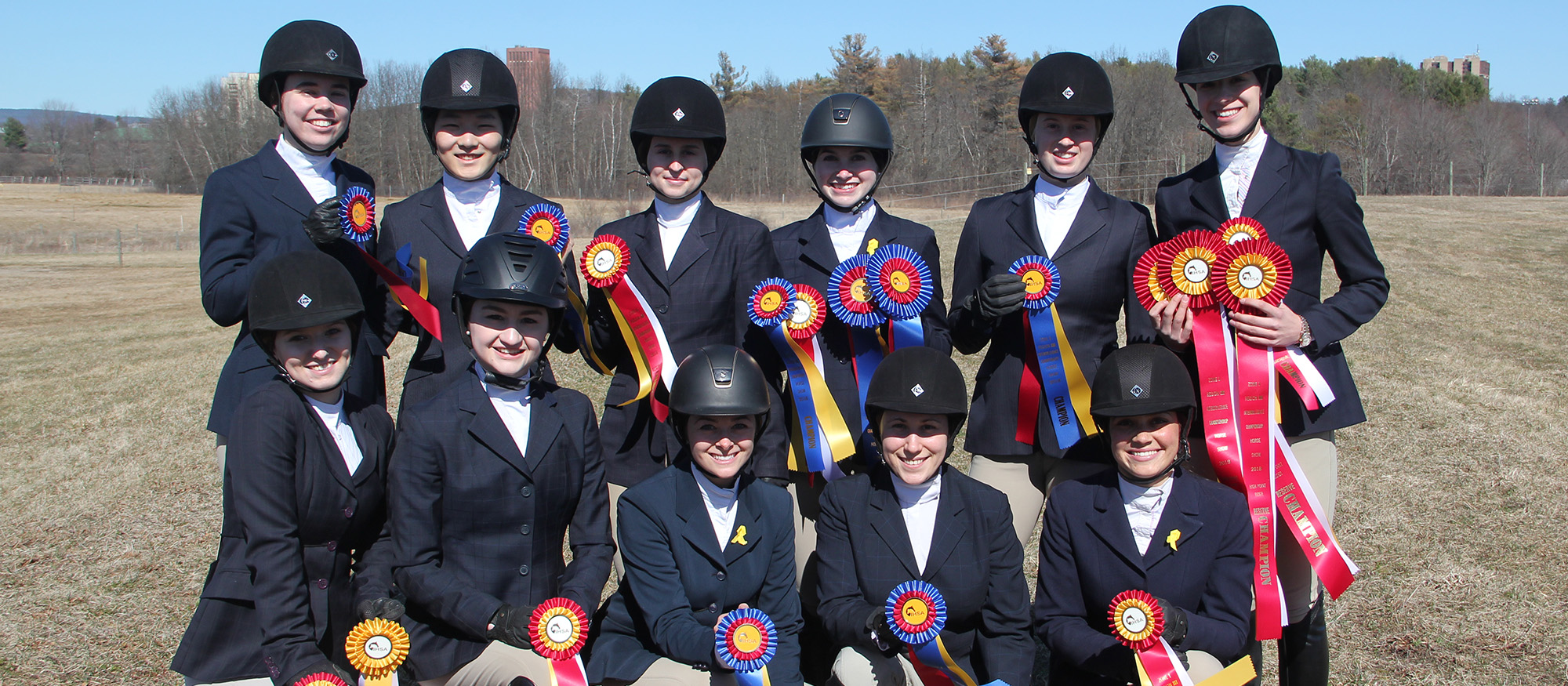 Group photo of the Lyons riding team following competition at the Regional Championships