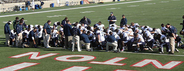 Wesley takes a knee after the game