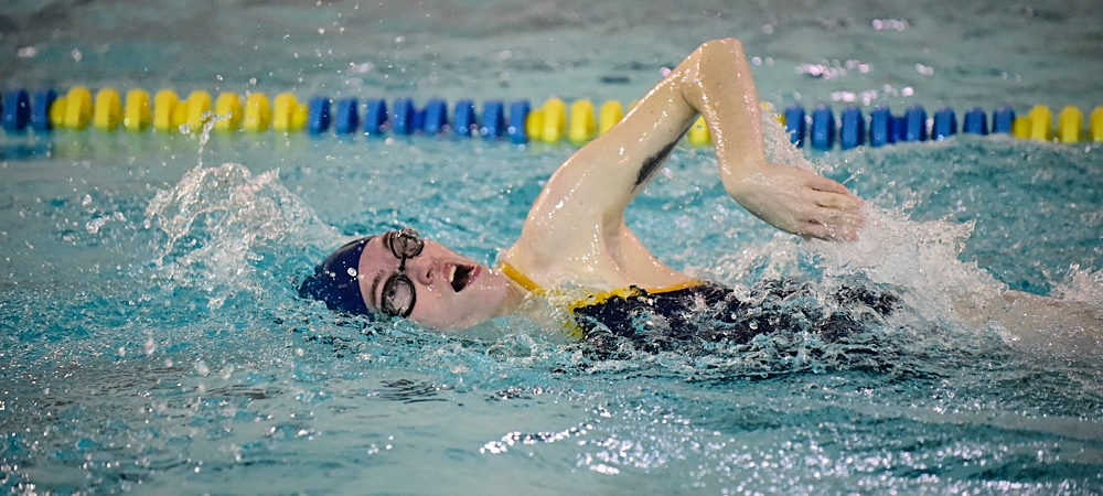 Kari McMinn swims the freestyle stroke in a pool for the Bison