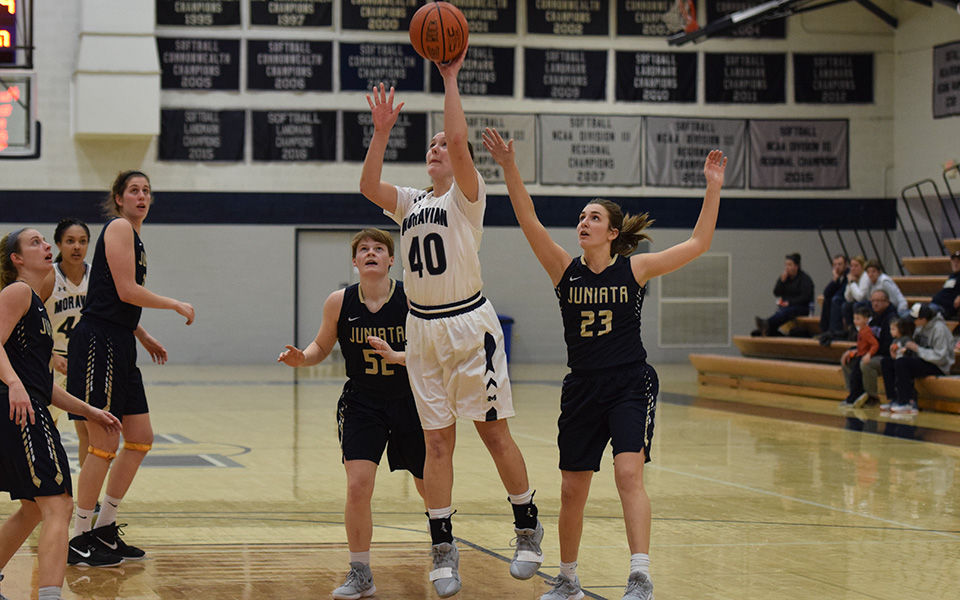 Senior forward Ariana Caiati makes a move to the basket versus Juniata College in Johnston Hall.
