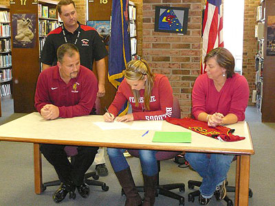 Jackson Northwest's Ashley Rando signs with FSU while her parents look on (Courtesy Photo)