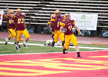 Junior LB Kyle Fitzpatrick trots into the endzone on his 65-yard INT return (Photo by Scott Whitney)